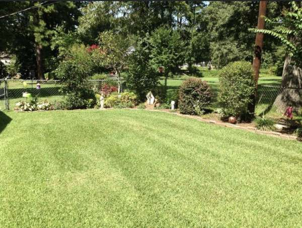 Lawnmowing side yard by HIS Way Services, Texarkana